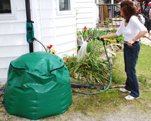 Tuff Tech 150 Gallon Flexible Rain Barrel In Use With A Hand Pump Photo